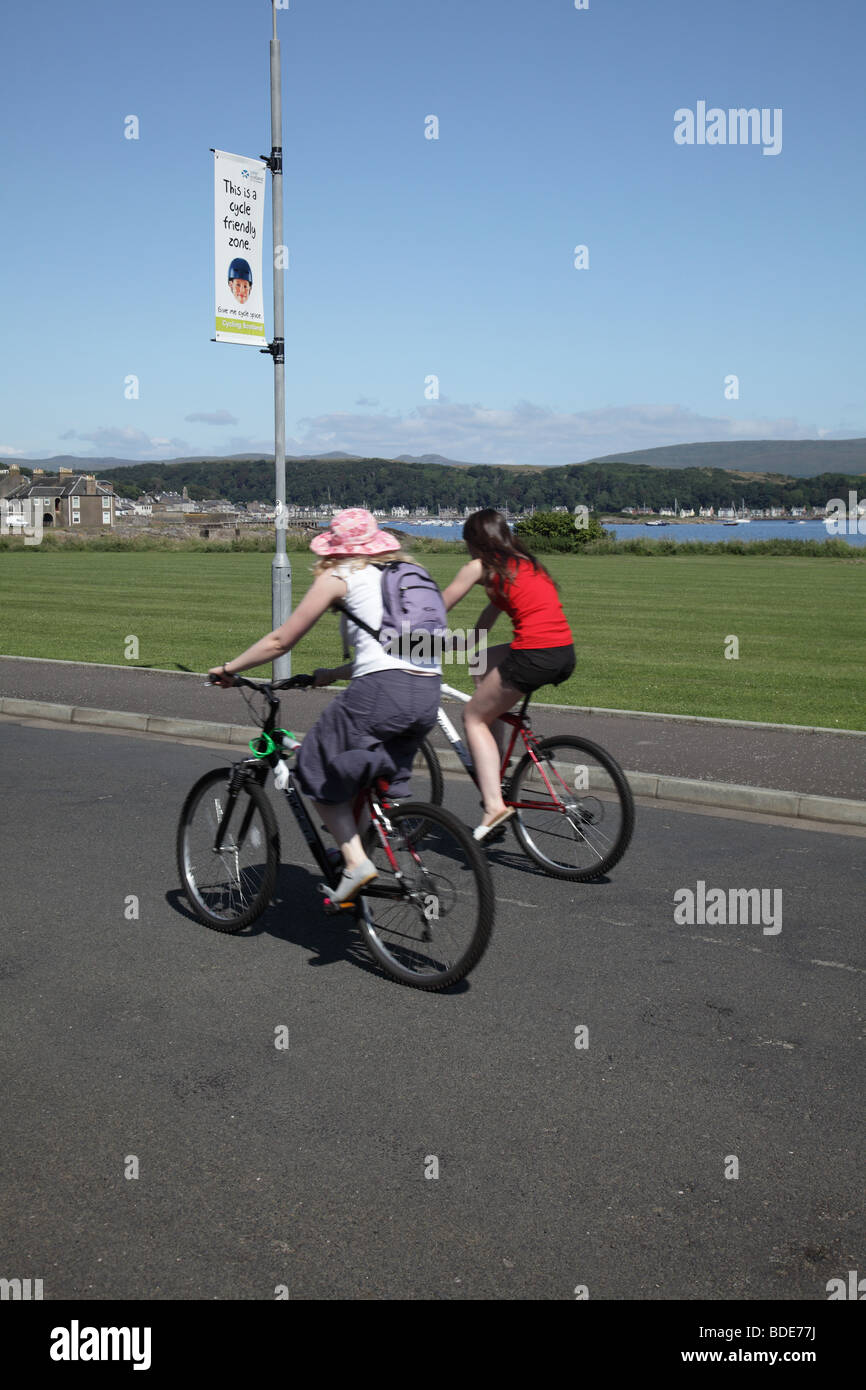 Cyclist in the town of Millport on the Island of Great Cumbrae, West Coast of Scotland, UK - Stock Image