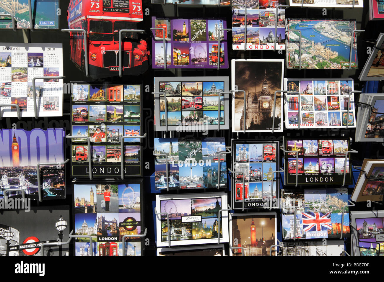 postcards of london on display outside a souvenir shop london uk - Stock Image