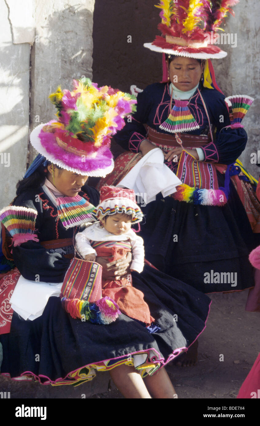 Women of Taquile Island, Lake Titicaca, Peru dress in their colorful costumes during the Illampu festival - Stock Image