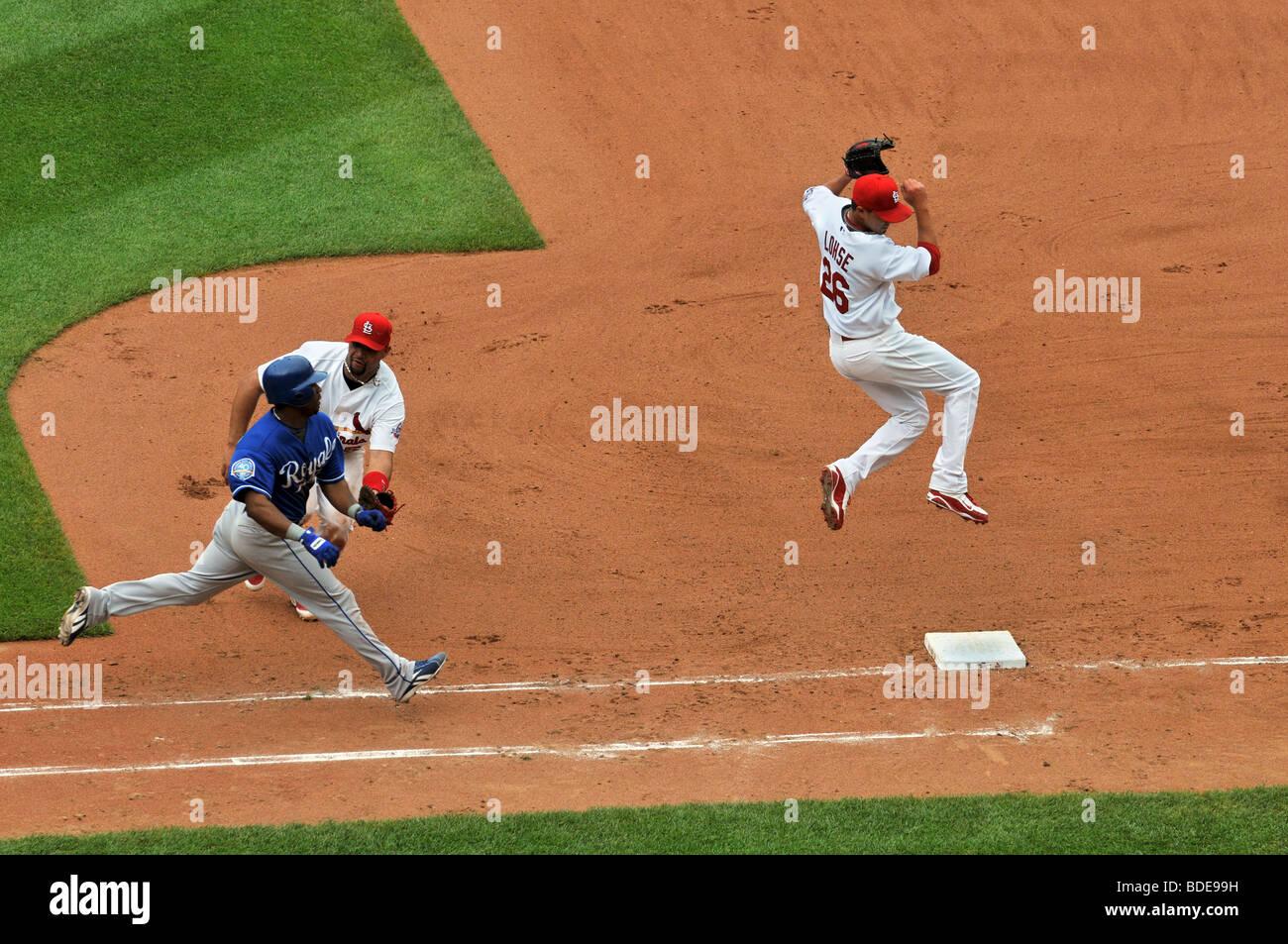 ST LOUIS - MAY 23: Albert Pujols of the Saint Louis Cardinals tags out Jose Guillen of the Kansas City Royals at - Stock Image