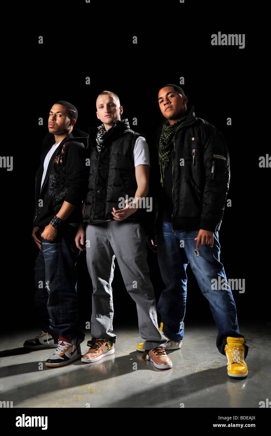 Hip hop dancers posing over a dark background - Stock Image