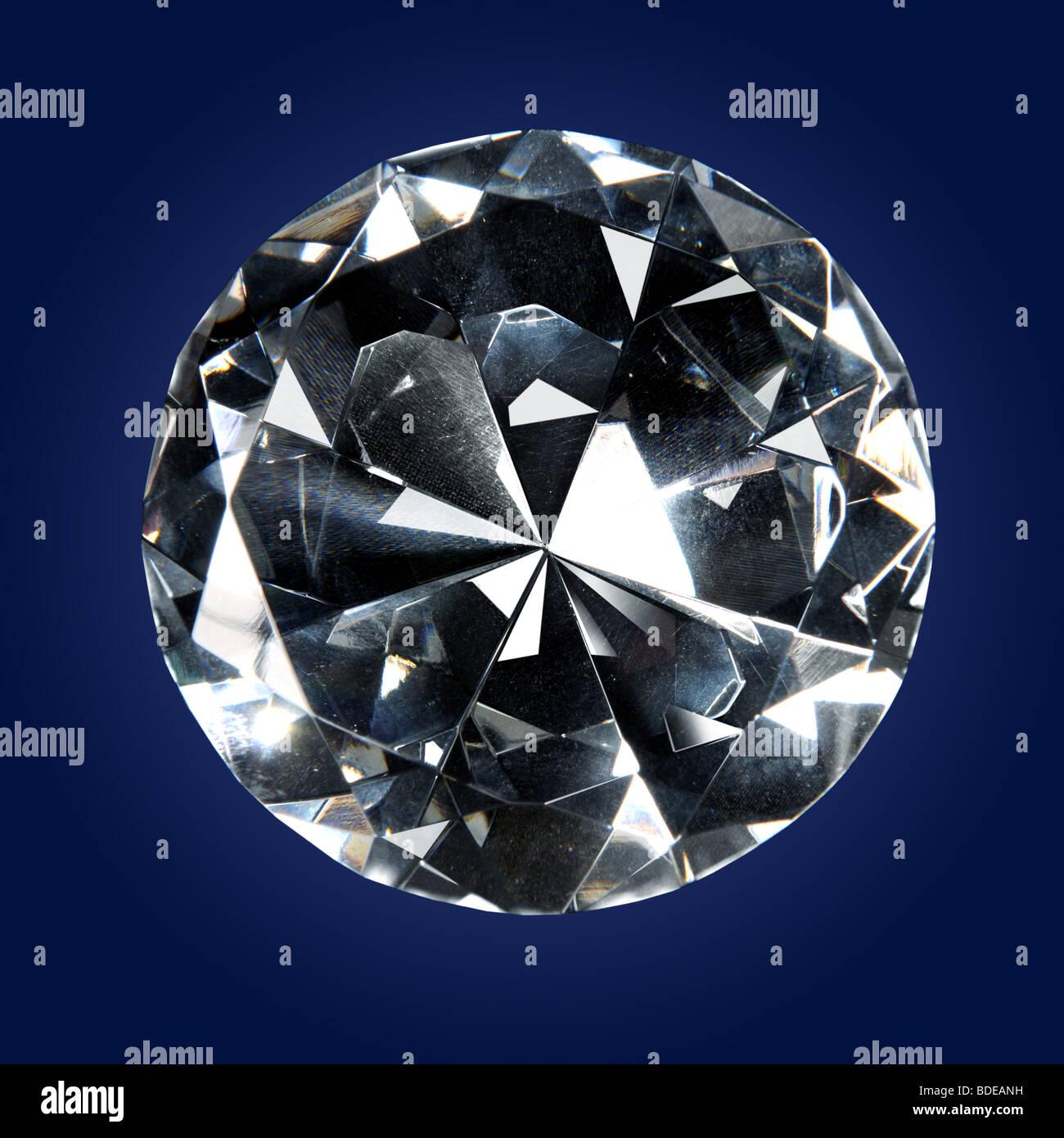 Single diamond over a dark background - Stock Image