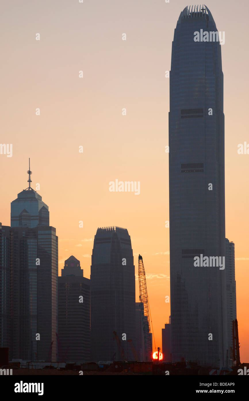 Sunset behind high rise buildings in Central District Chung Wan in Hong Kong, China. - Stock Image