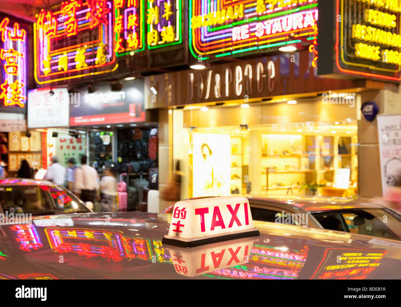 Neon signs and taxi light in Tsim Sha Tsui, Kowloon, Hong Kong, China. - Stock Image