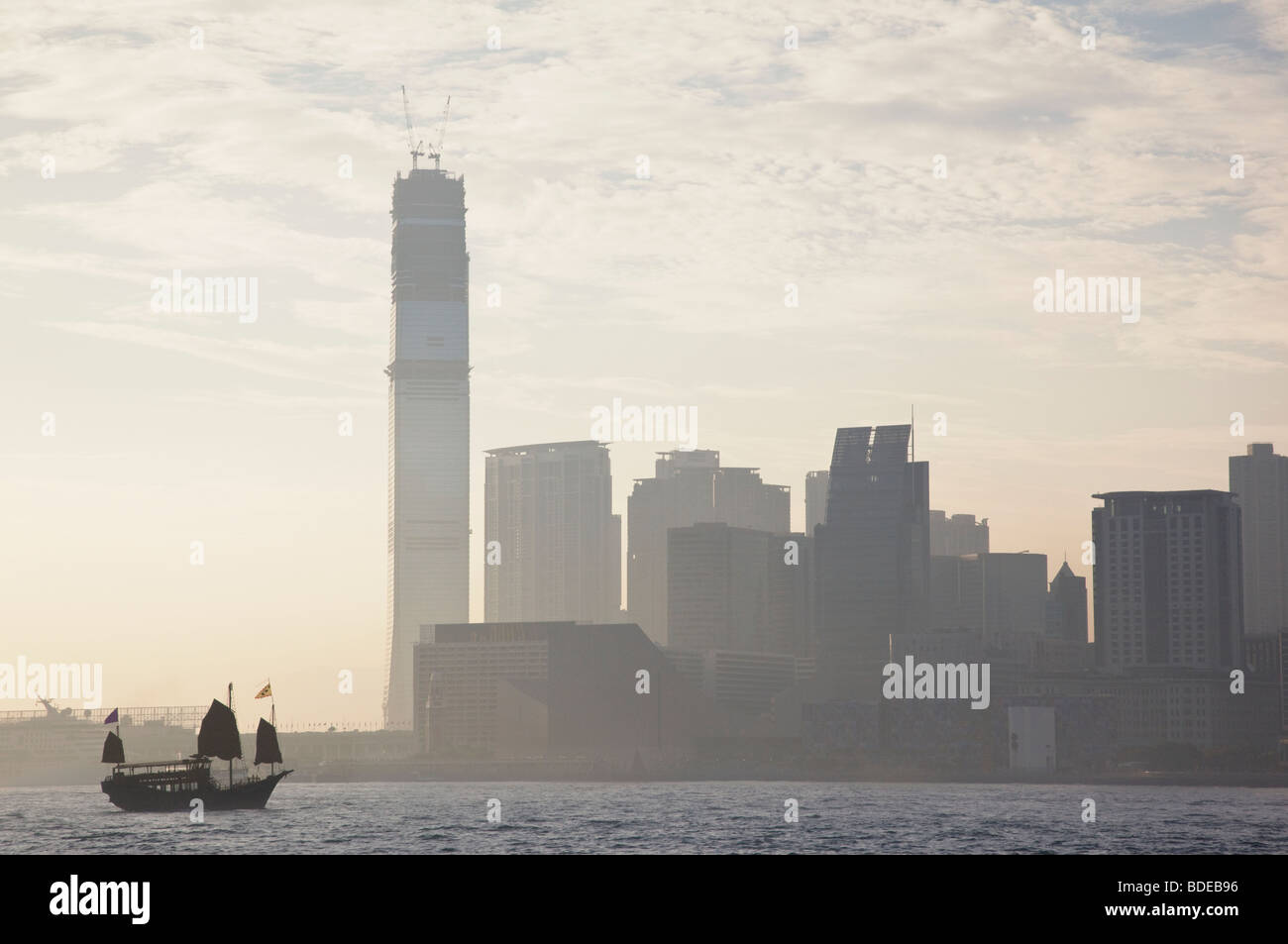 Junk boat in front of high rise buildings in Tsim Sha Tsui, Hong Kong, China. Stock Photo