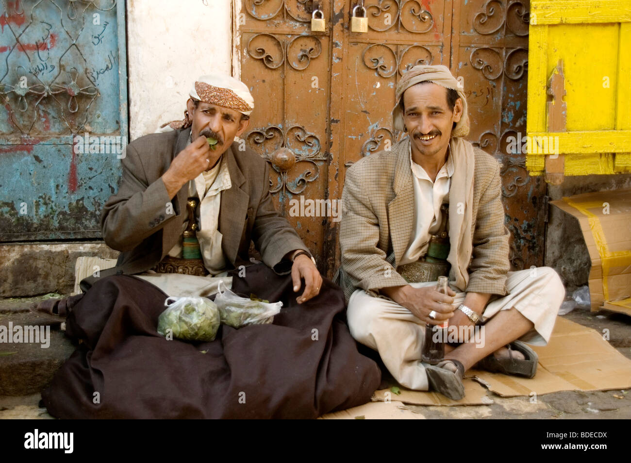 A portrait of two khat merchants, selling bags of the chewable leafy stimulant and legal drug, in the old market - Stock Image