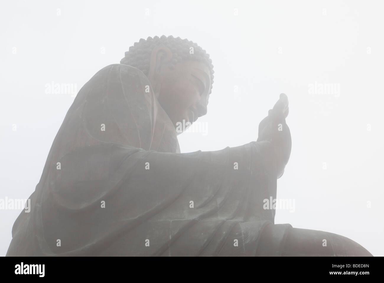 Giant Buddha in mist Po Lin Monastery, Hong Kong, China. - Stock Image