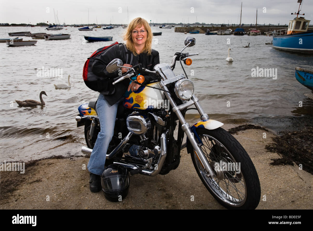 woman motorcyclist with her Harley Davidson bike - Stock Image