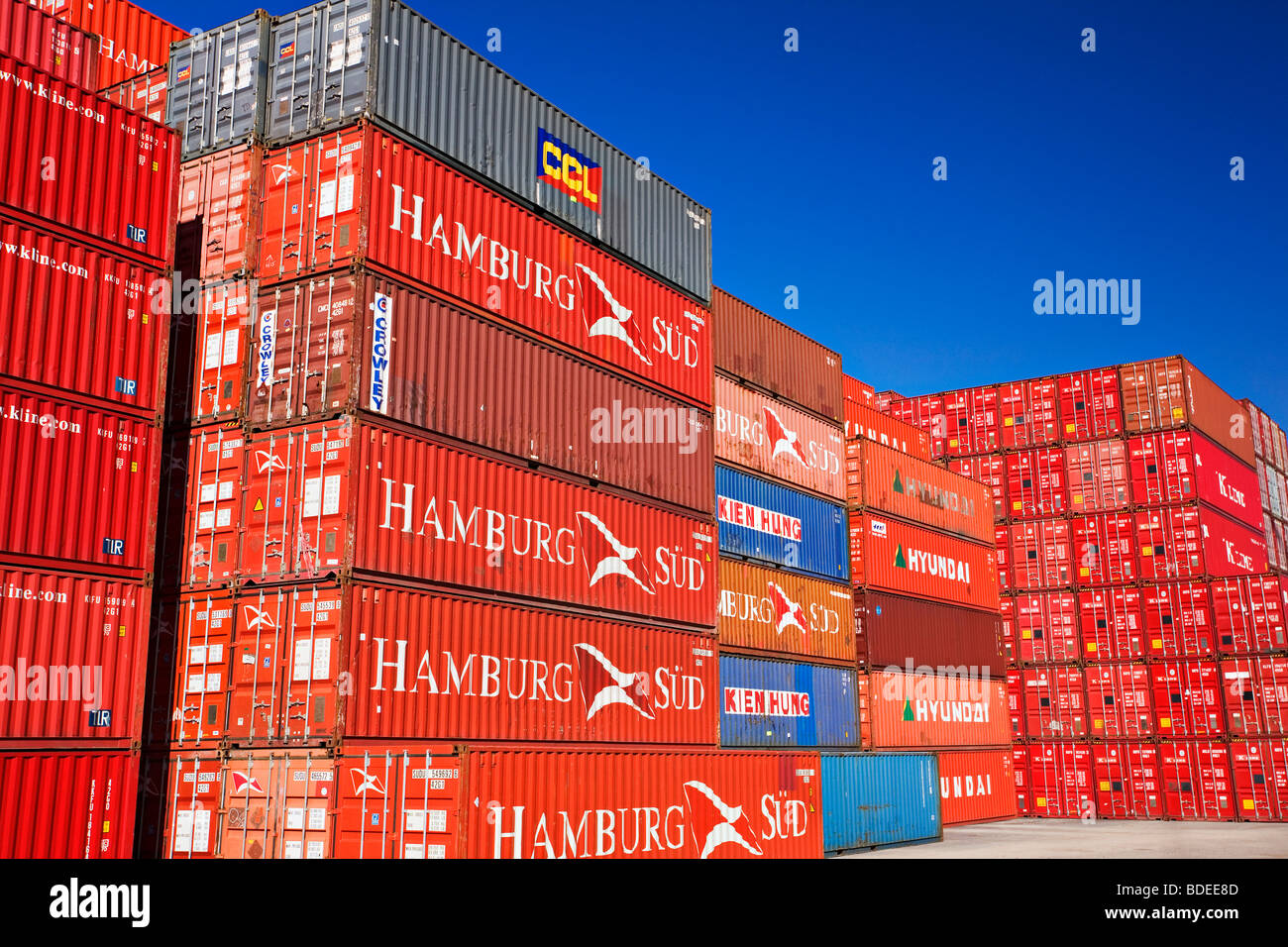 Shipping Industry / Shipping containers stacked at a port container terminal.The 'Port of Melbourne' Victoria - Stock Image
