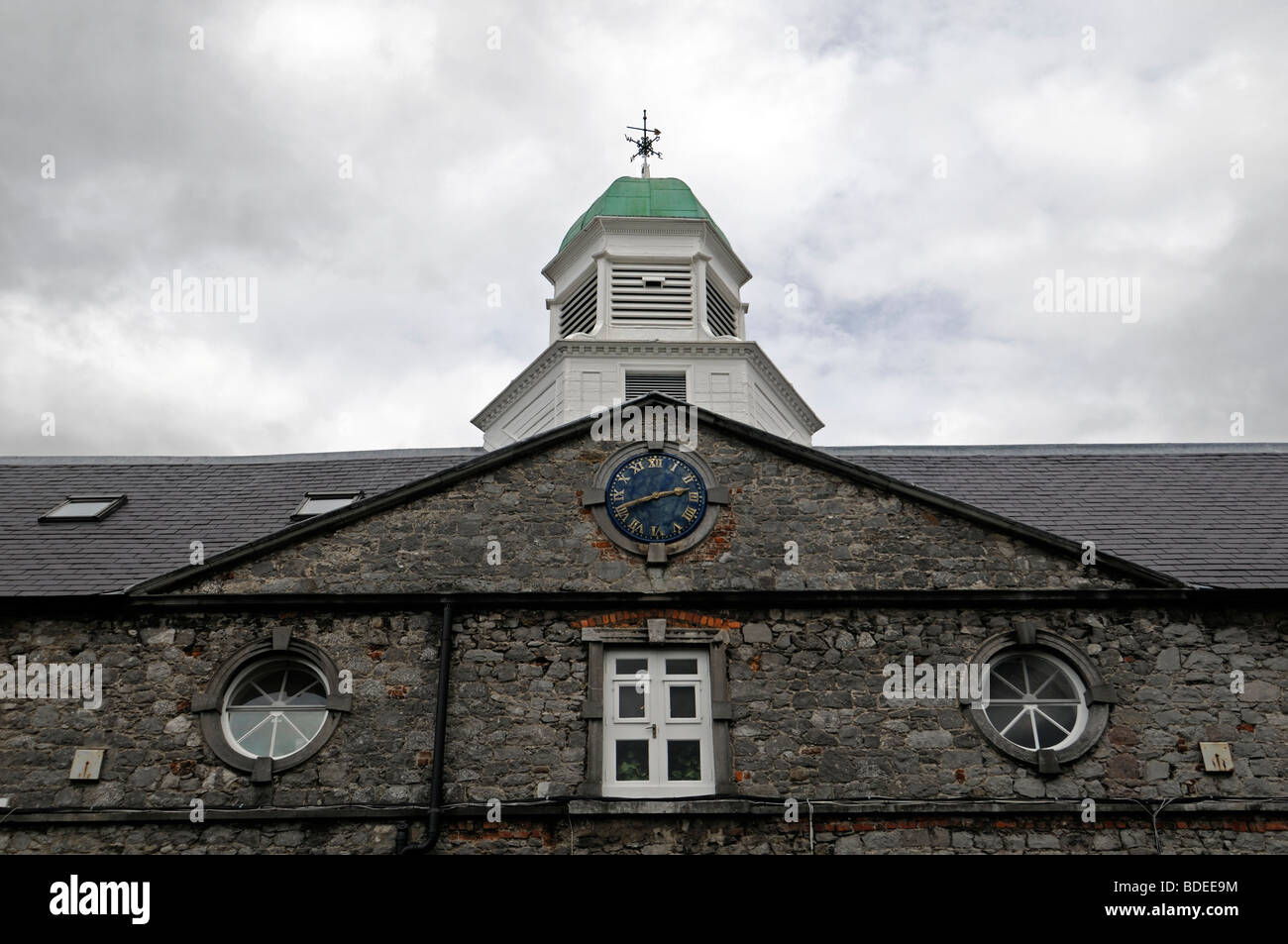 View of the clock tower in Kilkenny Workshops Converted Stables, Kilkenny City, County Kilkenny, Ireland - Stock Image