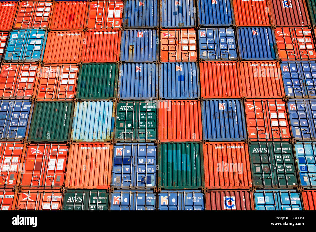 """Shipping Industry / Shipping containers stacked at a port container terminal.The """"Port of Melbourne"""" Victoria Australia. Stock Photo"""