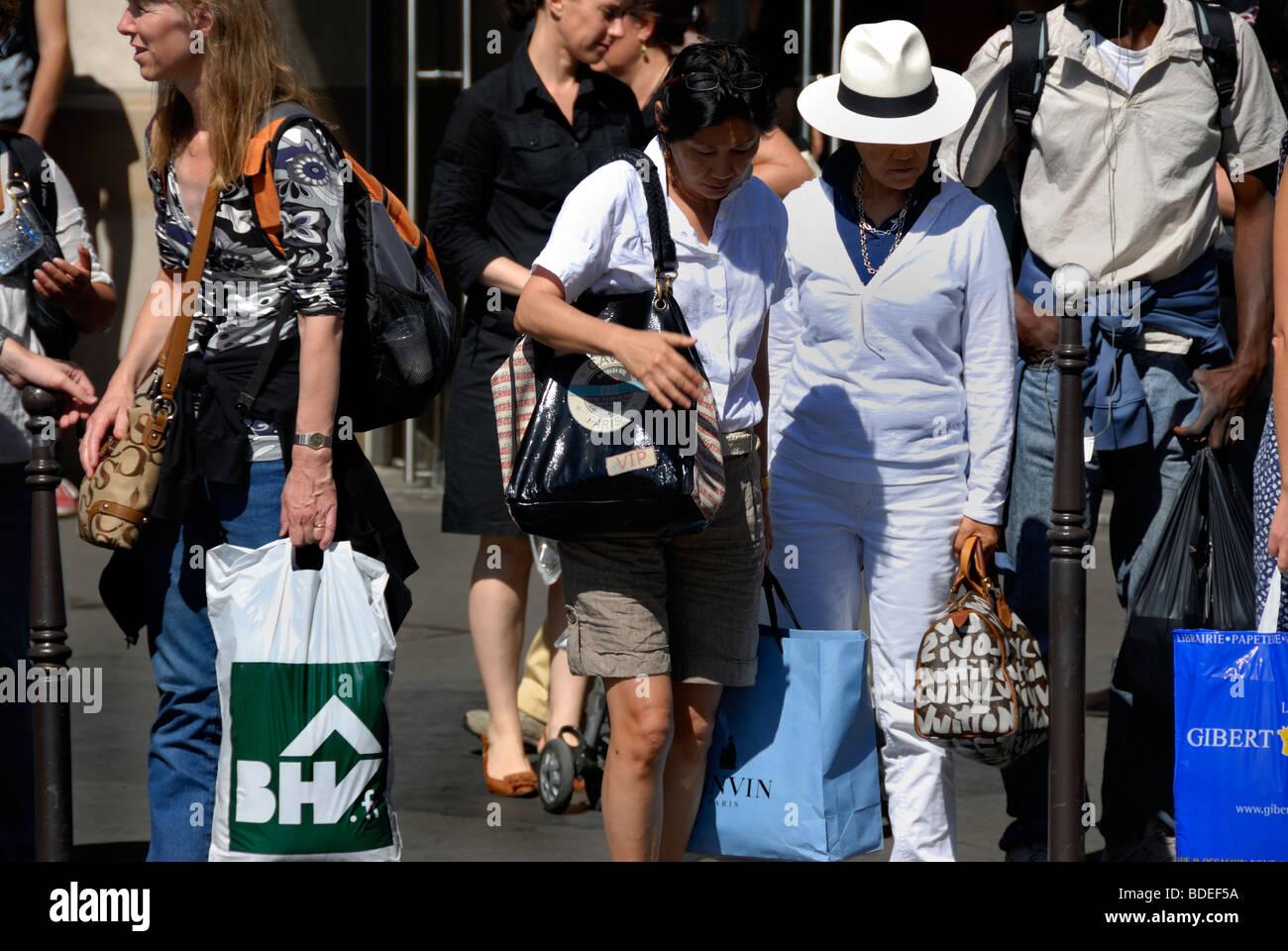Paris, France, Clothes Shopping Street, Woman Carrying 'Shopping Bags', 'Rue de Rivoli', Summer - Stock Image