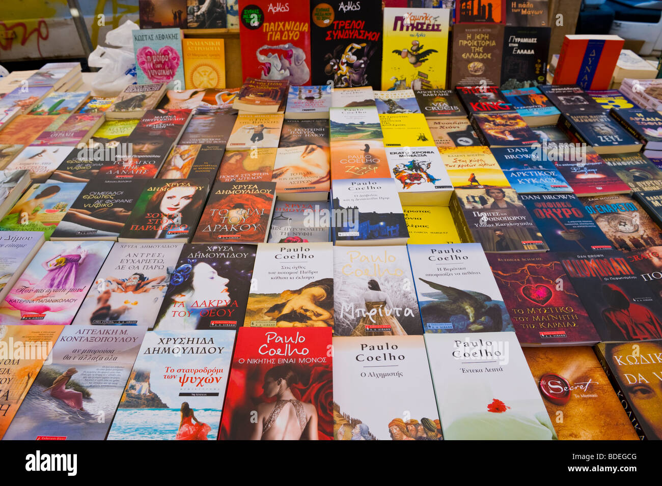 Greek language paperback books for sale at annual festival market at St Gerasimos Monastery on the island of Kefalonia - Stock Image