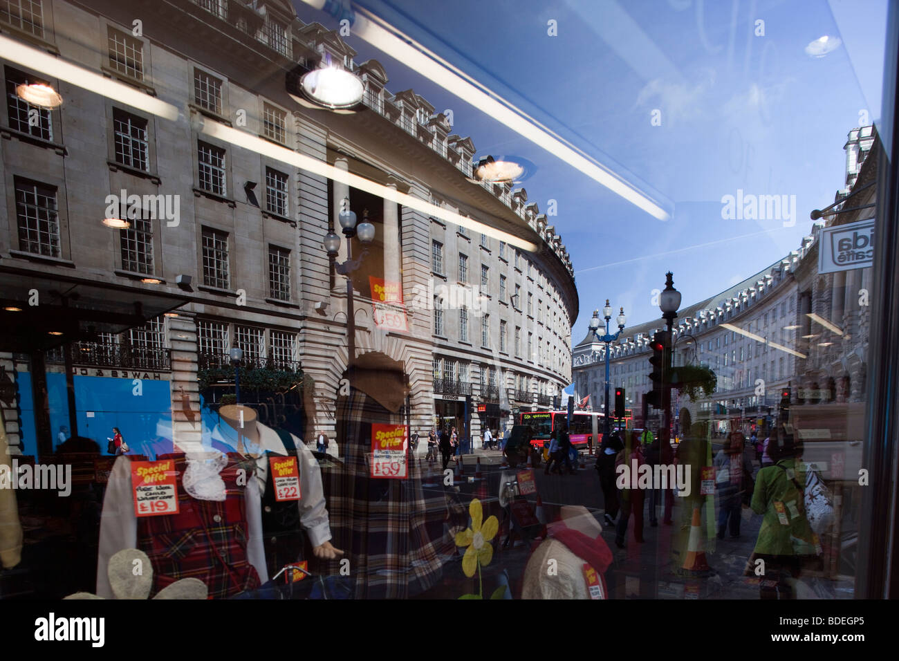 Reflections on a shop window, Regent Street, Westminster, London, England, United Kingdom - Stock Image