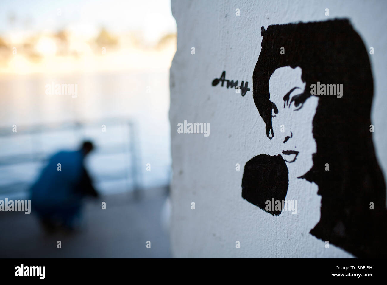 Stencil graffiti depicting Amy Winehouse, Betis street, Seville, Andalusia, Spain - Stock Image