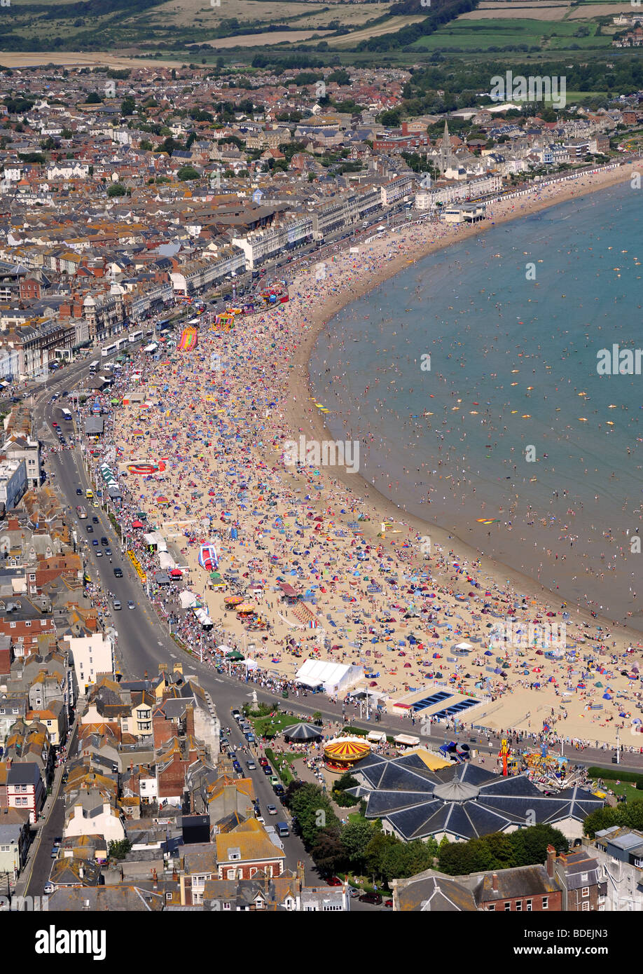 Beach, Weymouth beach, Aerial view of tourists on Weymouth beach during hot weather in Dorset, Britain, UK - Stock Image