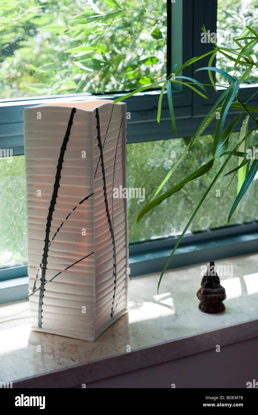 Interior design, Paper lantern on a windowsill Stock Photo