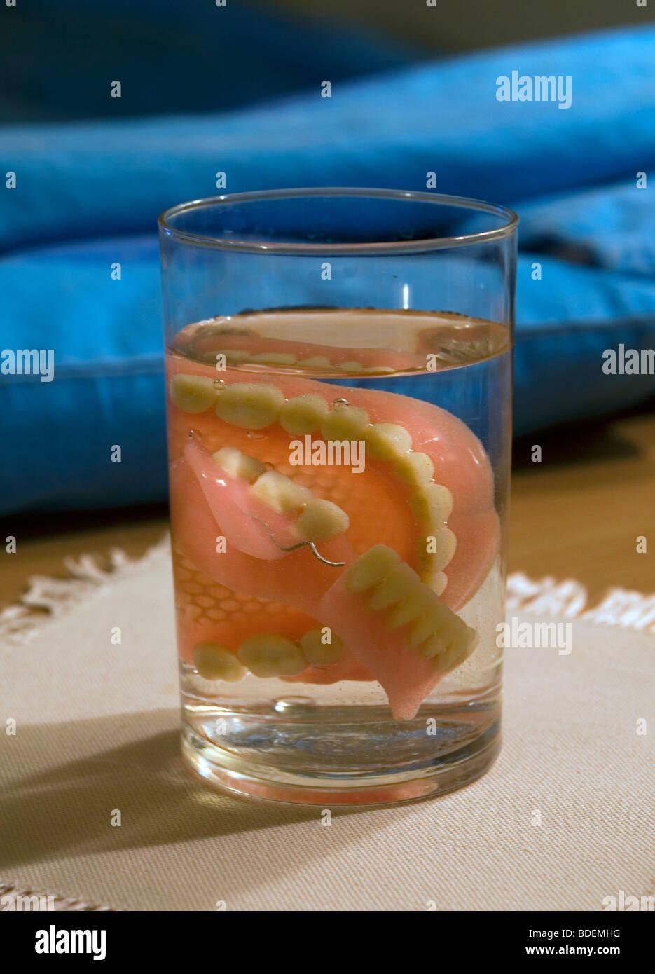 Denture in glass - Stock Image