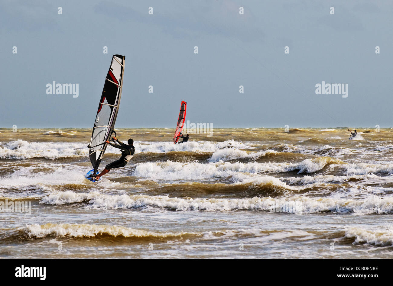 Windsurfers in the sea off Camber Sands in Sussex.  Photo by Gordon Scammell - Stock Image