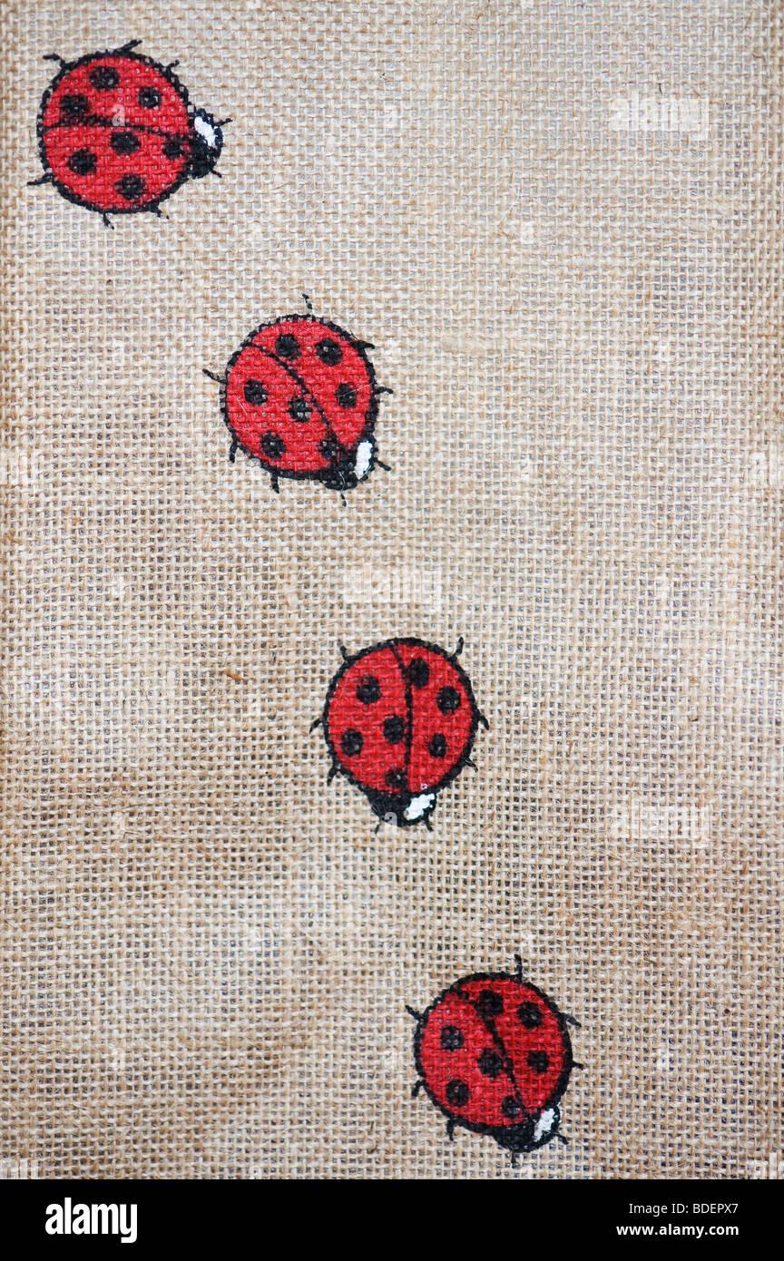 Ladybirds on a hessian environmentally friendly shopping bag - Stock Image