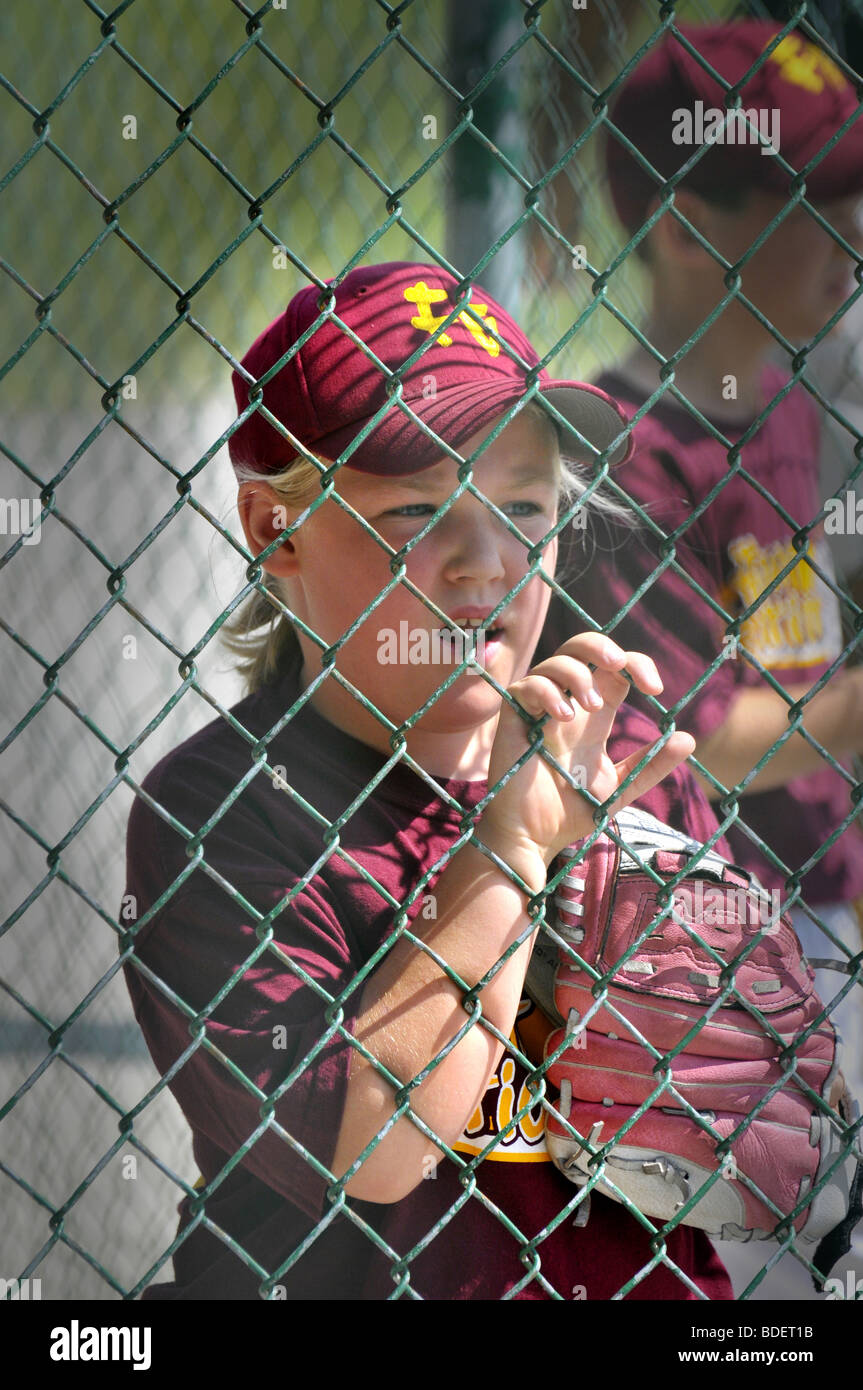 Little league baseball action with 8 and 9 year old players - Stock Image