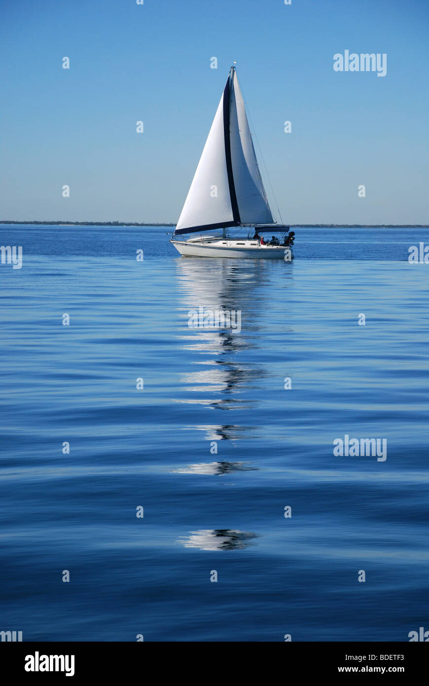 A sailing vessel's reflection on the water. Gulf of Mexico, Florida USA - Stock Image