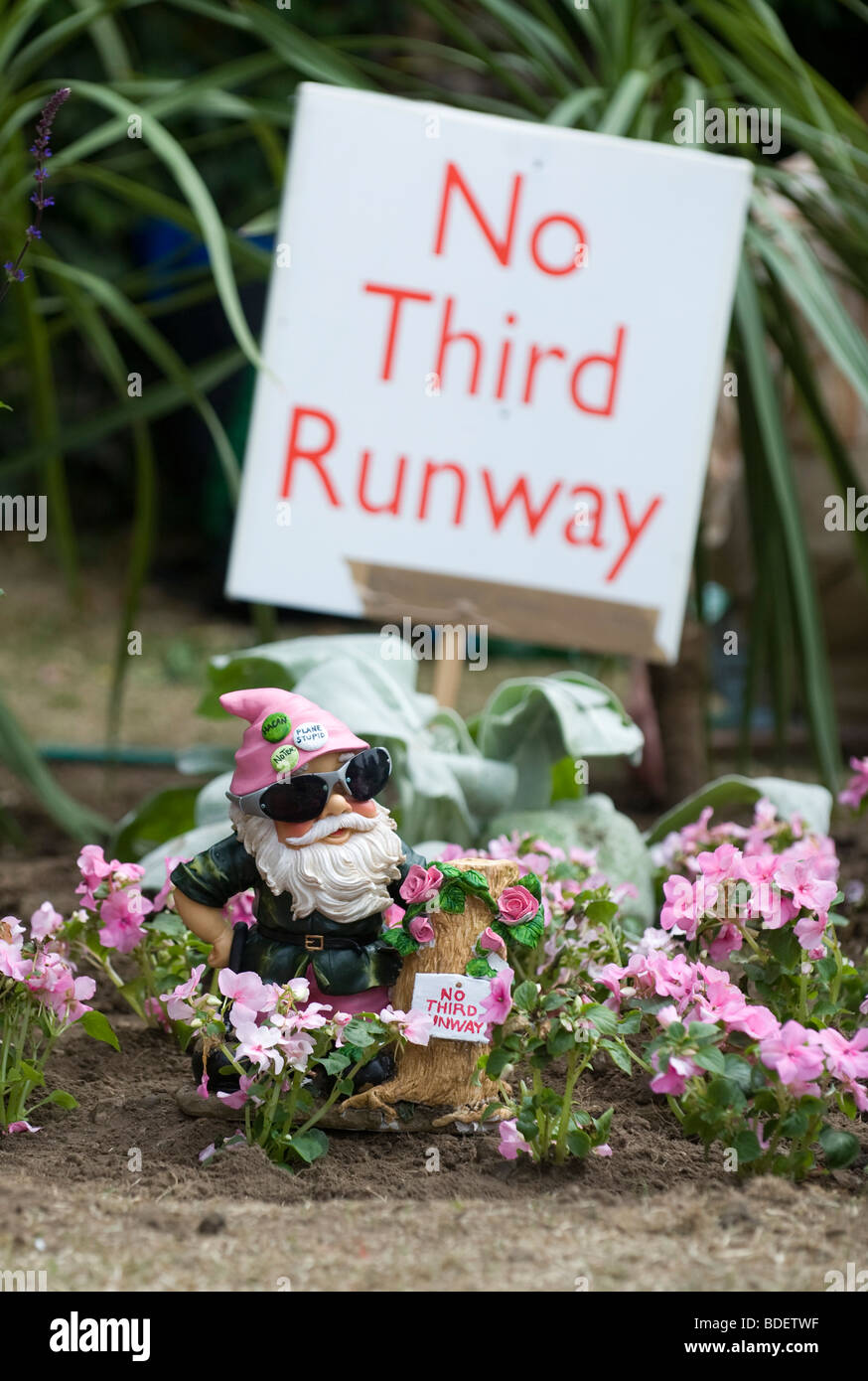 A protest garden against the third runway at Heathrow created with  discarded plants and flowers from the Chelsea - Stock Image