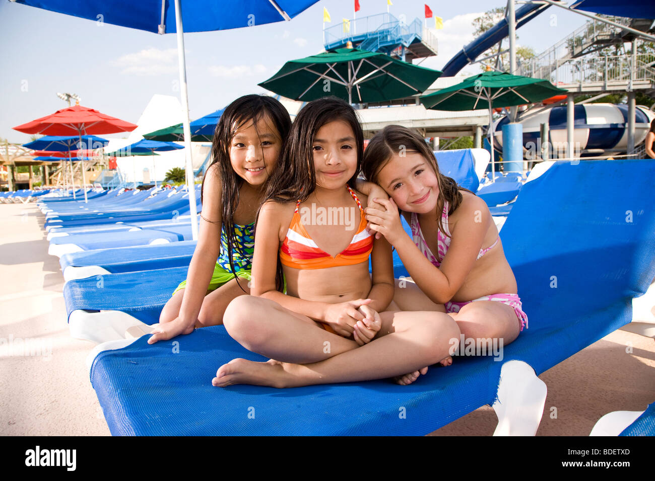 Terrific Multi Ethnic Girls In Swimsuits Sitting On Lounge Chair In Camellatalisay Diy Chair Ideas Camellatalisaycom