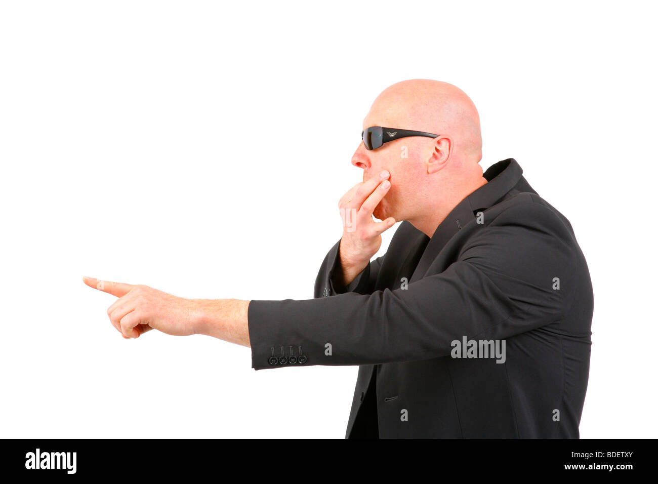 bald headed businessman calling someone off - Stock Image