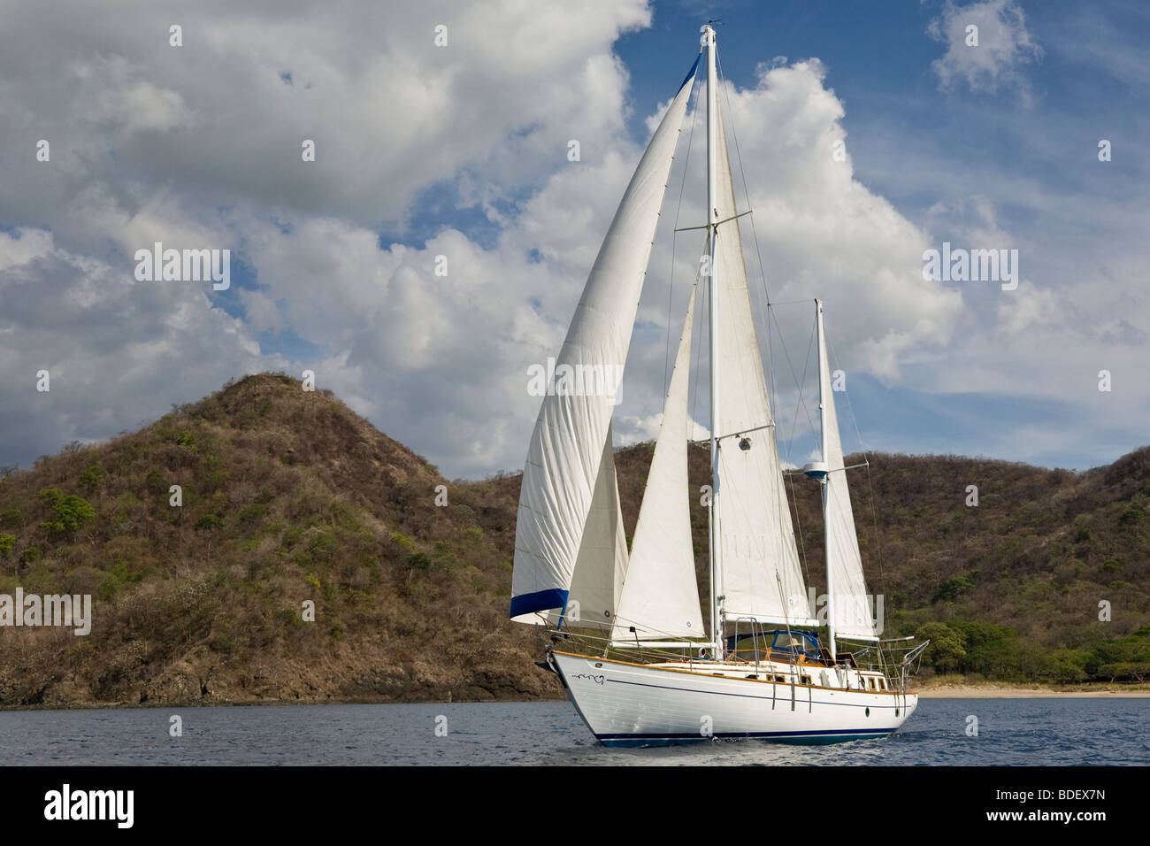 Ketch rig sailboat cruising along the shoreline in the Papagayo Bay, Guanacaste, Costa Rica. Stock Photo