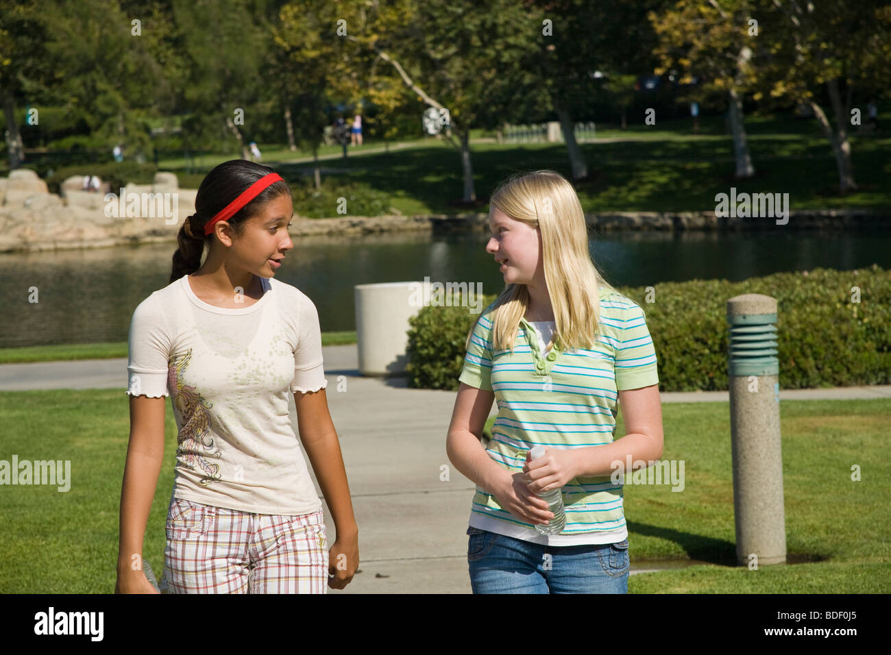 Two girls Racially mixed mix Ethnic diversity hang hanging out together Hispanic and Caucasian junior high girls - Stock Image