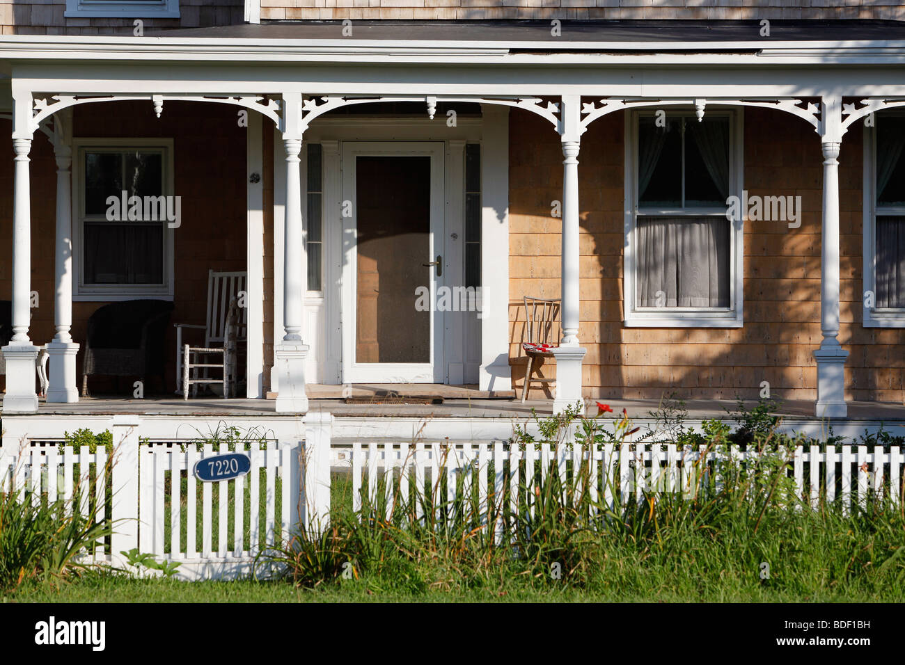 House with a porch, white picket fence, Orient Point, Long Island New York - Stock Image