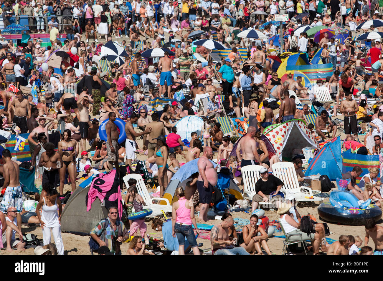 British Summer - crowded beach on a hot August weekend at Bournemouth - Stock Image