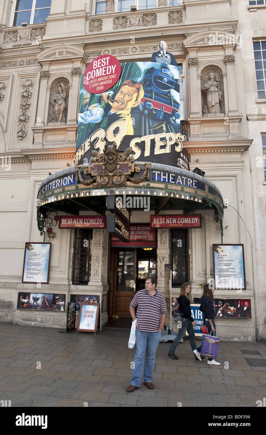 Large colourful billboards advertising 'The 39 Steps' comedic play on front of The Criterion Theatre, Picccadilly - Stock Image