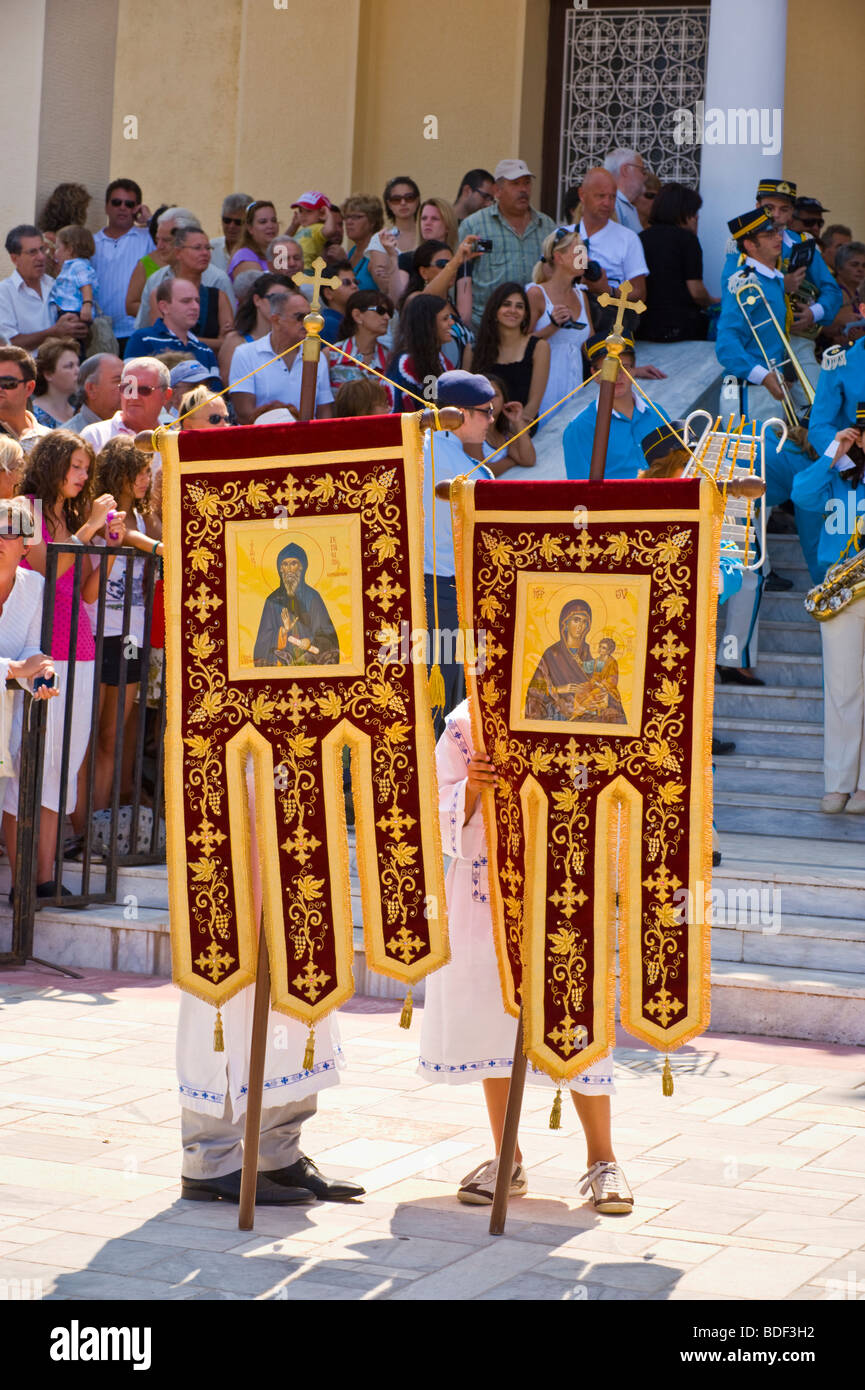 Banners lead annual festival procession at St Gerasimos Monastery on the Greek Mediterranean island of Kefalonia - Stock Image