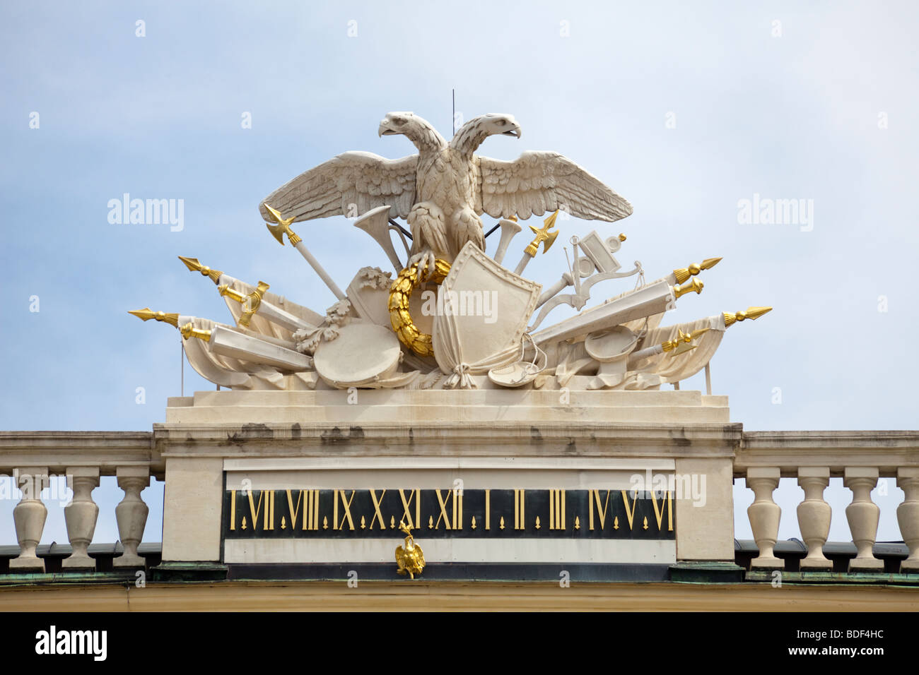 detail of coat of arms and clock at top of central unit, Schönbrunn Palace, Vienna, Austria - Stock Image