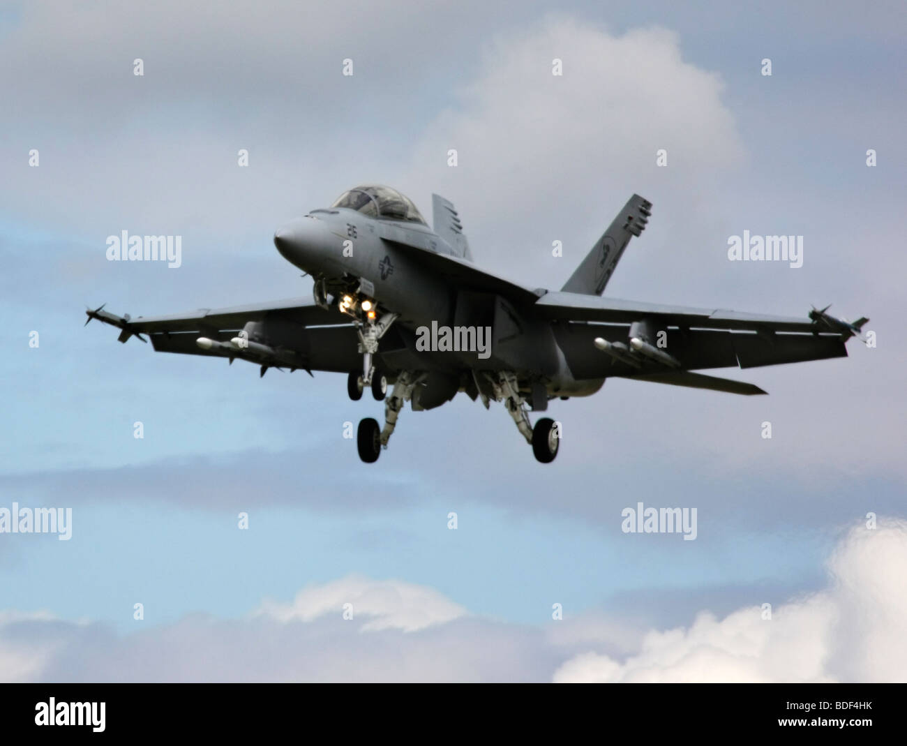 American Boeing FA-18 Super Hornet Jet landing with dynamic cloud background at the Farnborough Air Show in 2008 Stock Photo