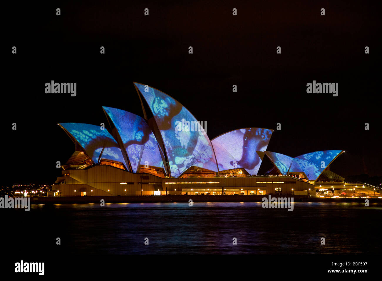 Australia, Sydney, the sails of Sydney Opera lit up in the LUMINOUS lightshow - Stock Image