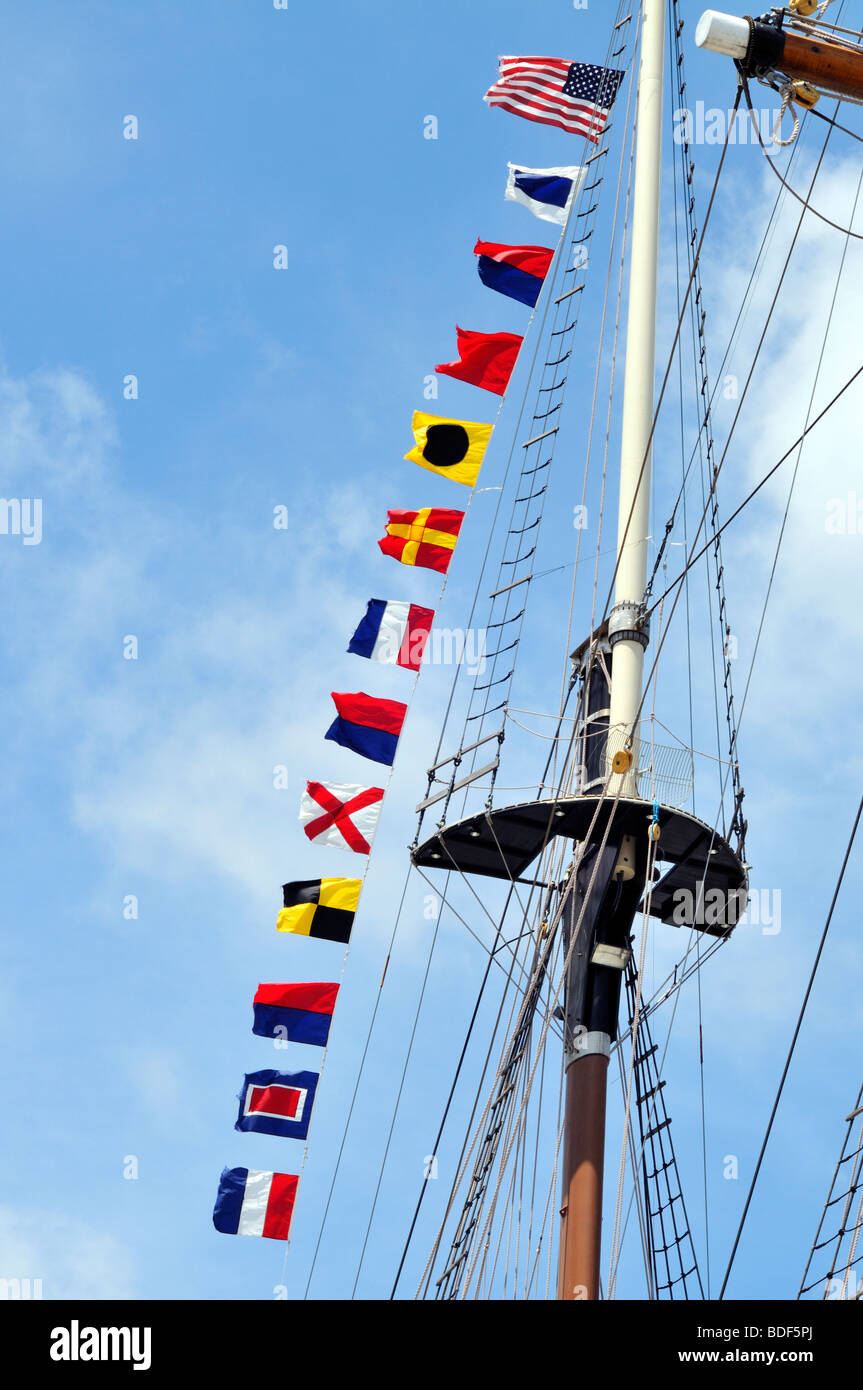 Sailing ship upper mast and flags - Stock Image