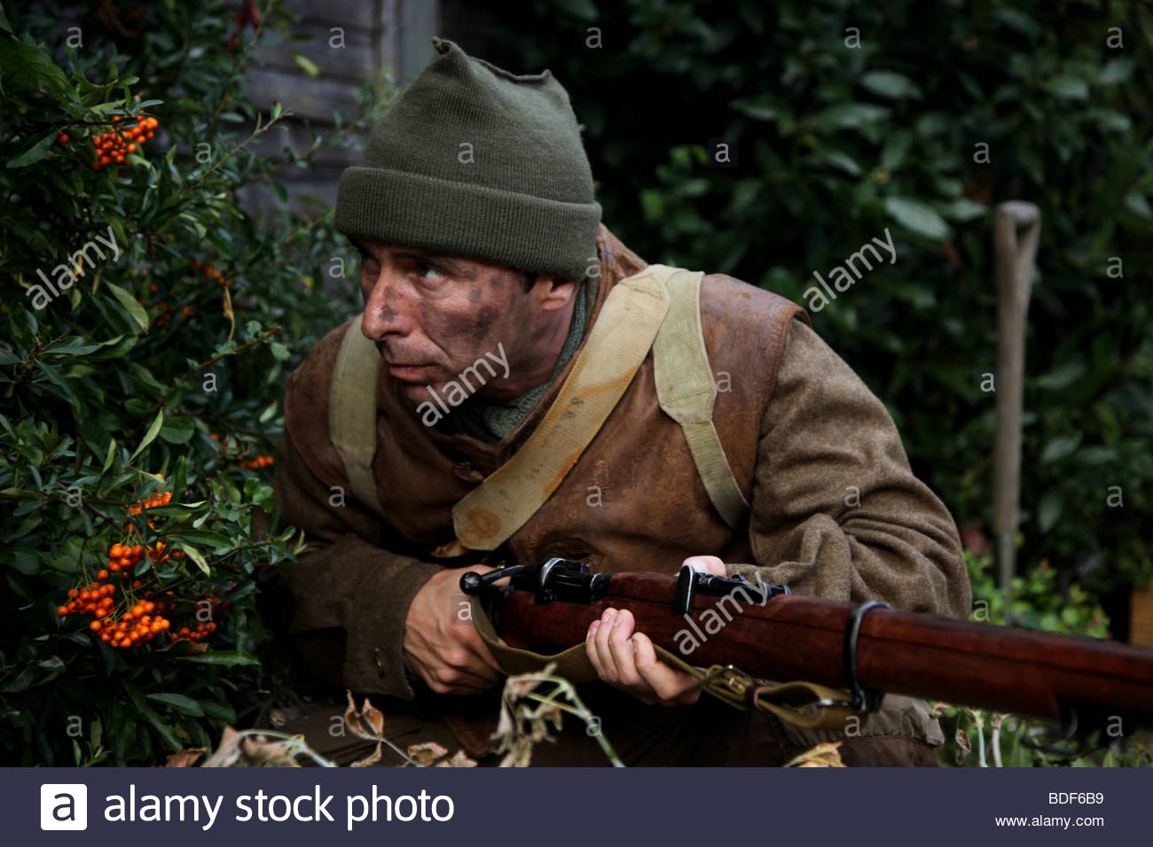 A British commando, hiding from the enemy - Stock Image