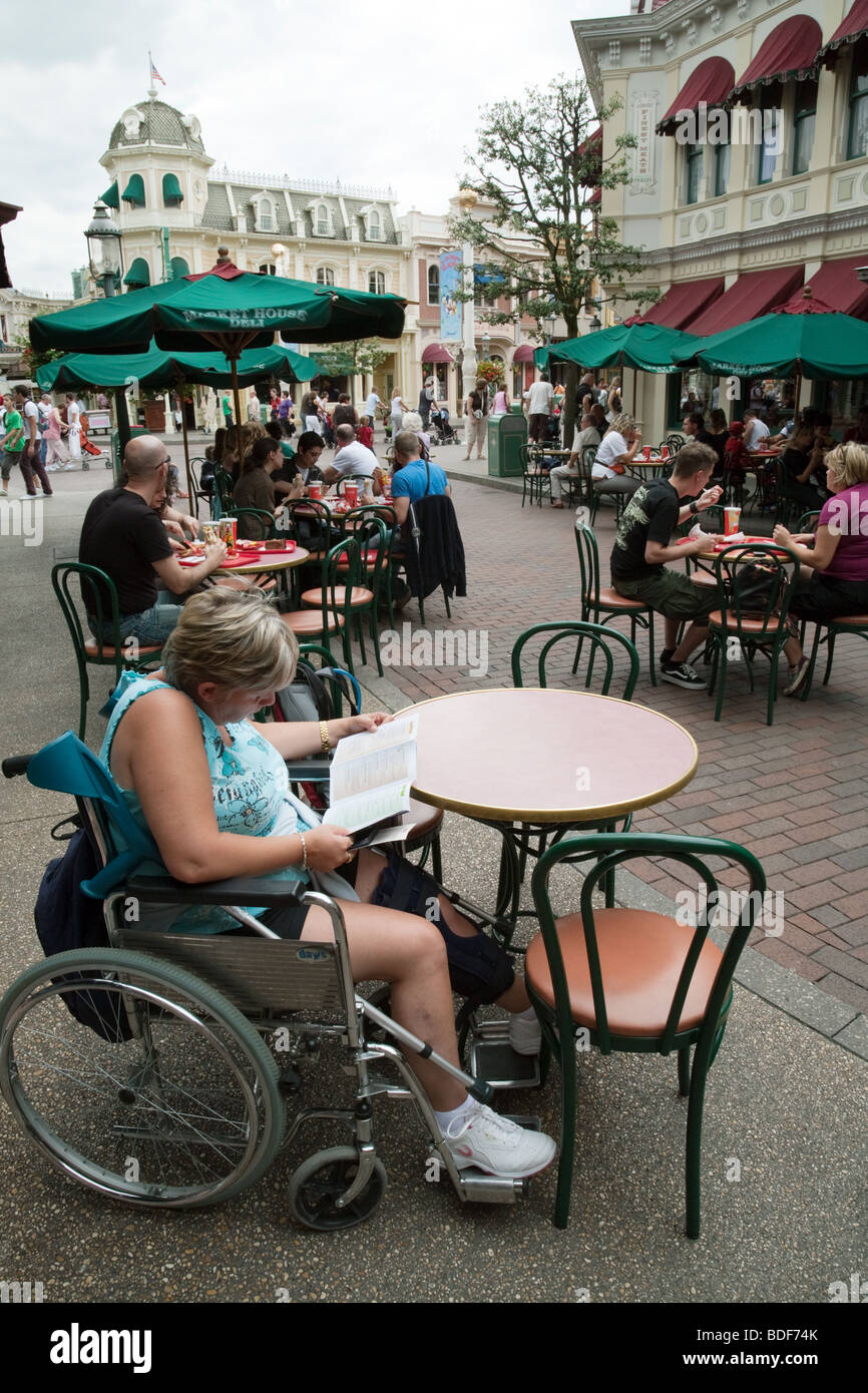 A disabled lady in a wheelchair at Disneyland, Paris, France - Stock Image