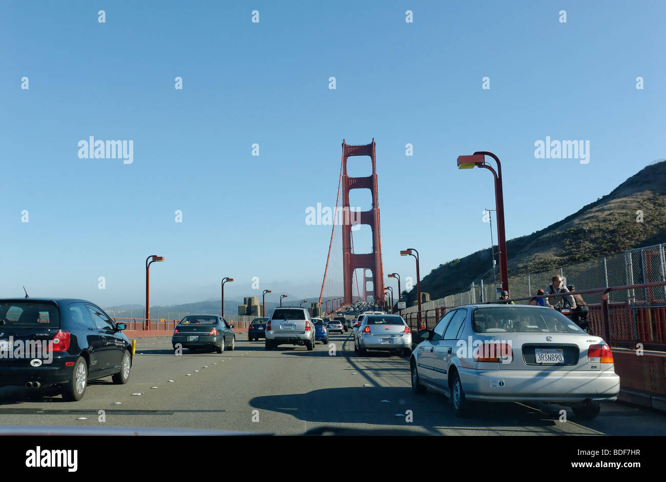 View of the Golden Gate Bridge while crossing it. Stock Photo