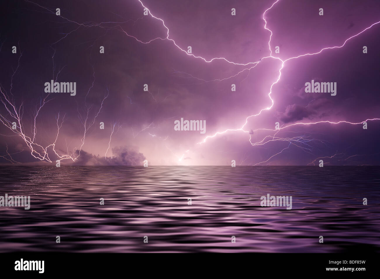 Lightning over water - Stock Image