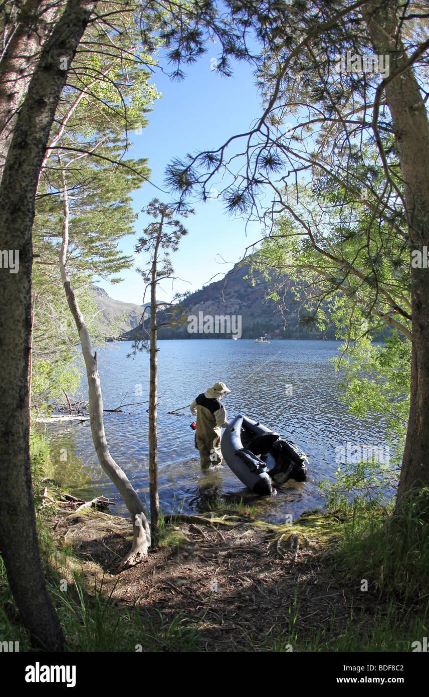Pontoon Fisherman in a Sierra Mountain Lake - Stock Image
