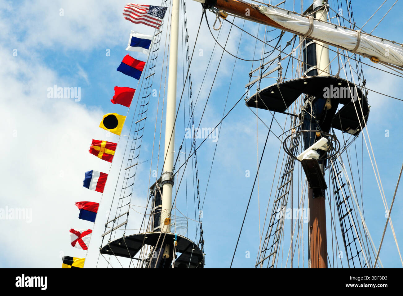Tallship upper mast with flags - Stock Image
