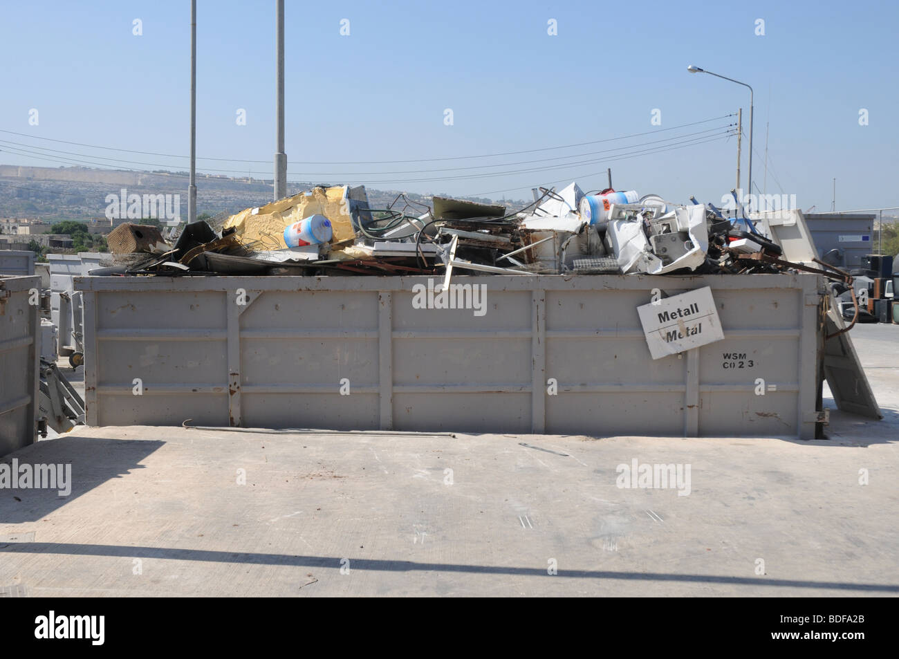 A section in a civic amenity site where metal scrap is source separated and disposed for recycling. Waste management Stock Photo