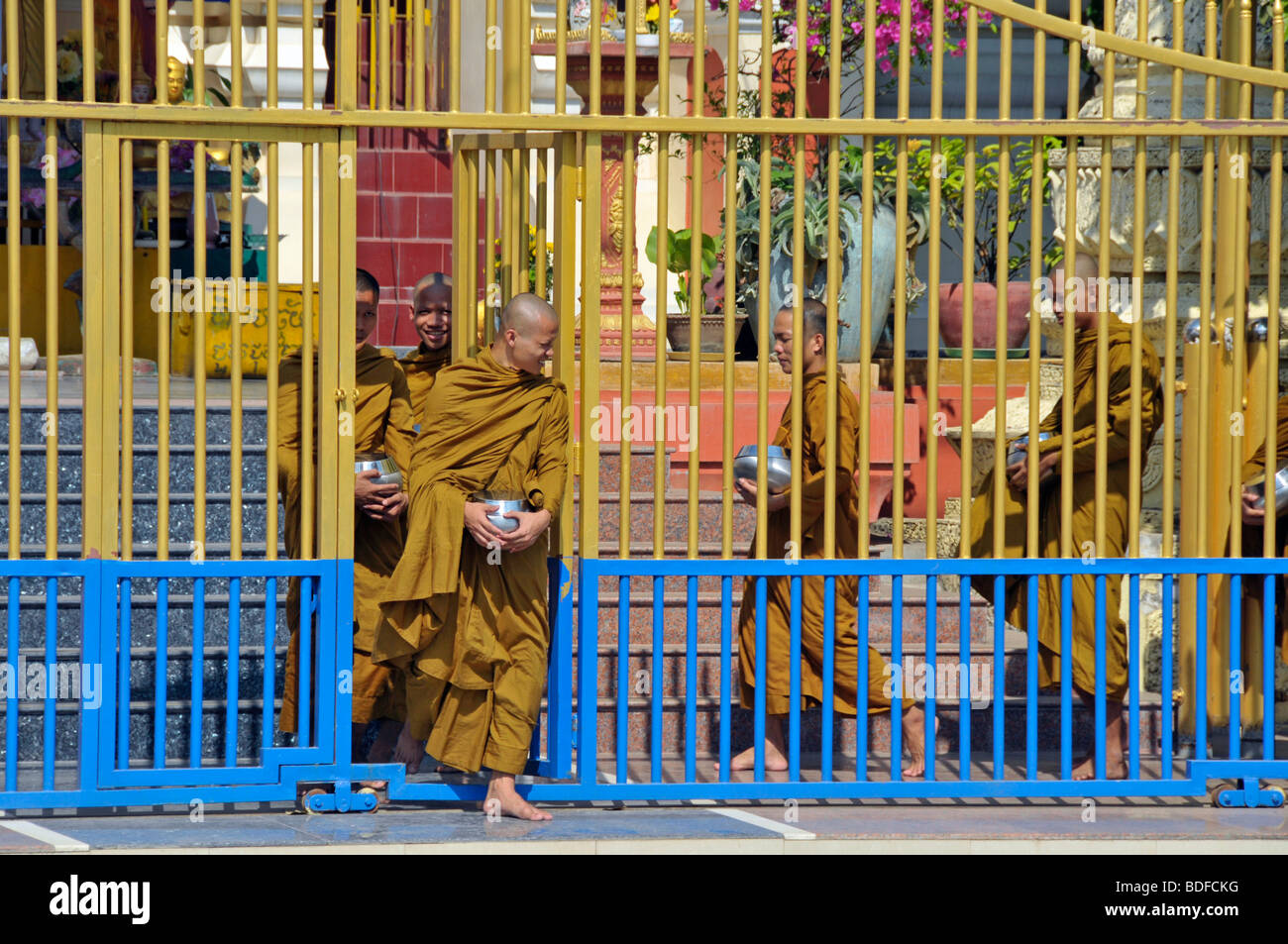 Monks leaving their monastery to go begging for alms, Binhabad with begging or alms bowl, Phnom Penh, Cambodia, - Stock Image