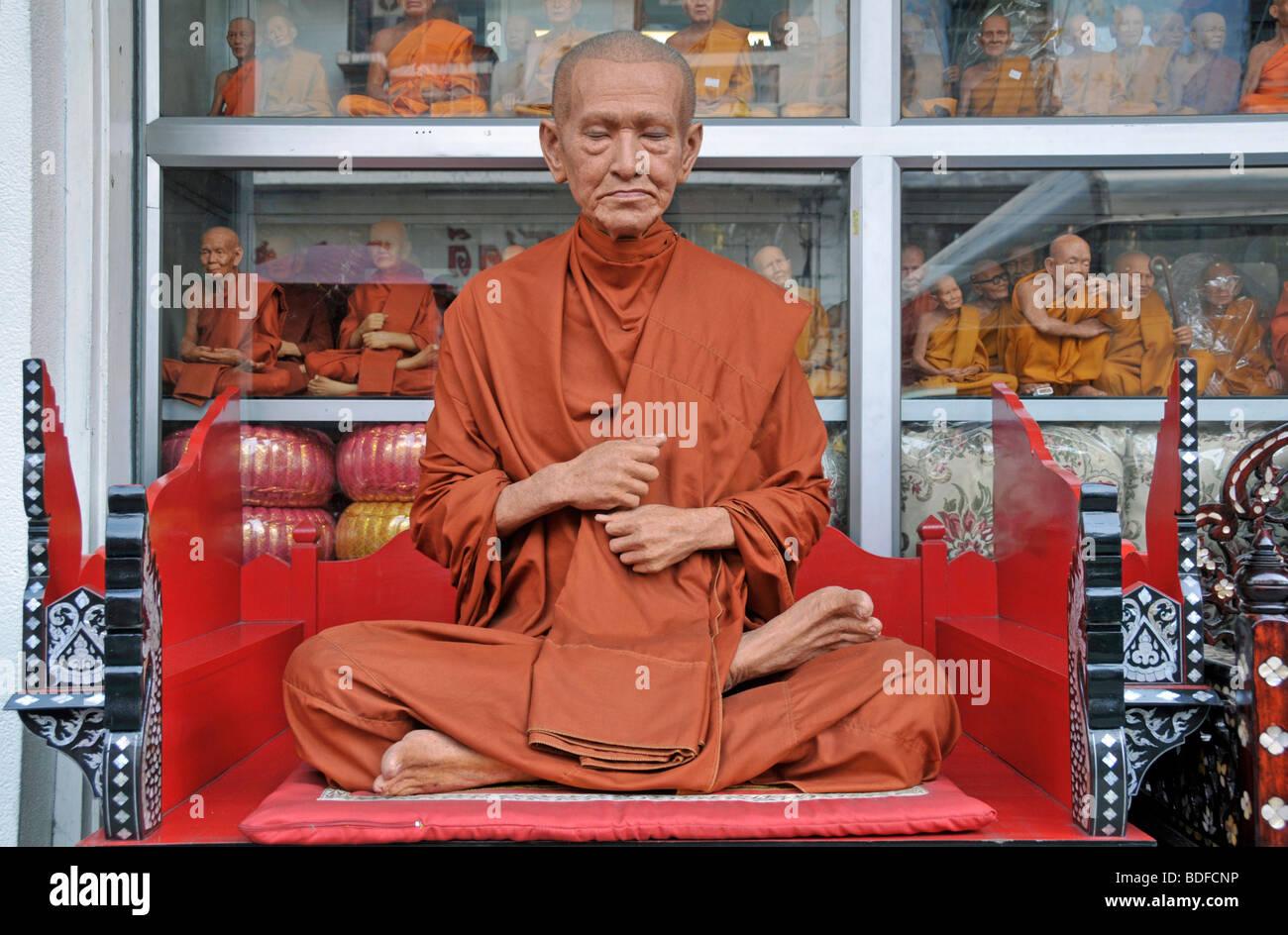 Deceptively lifelike monk figure, Bamrung Muang Road, Bangkok, Thailand, Asia - Stock Image