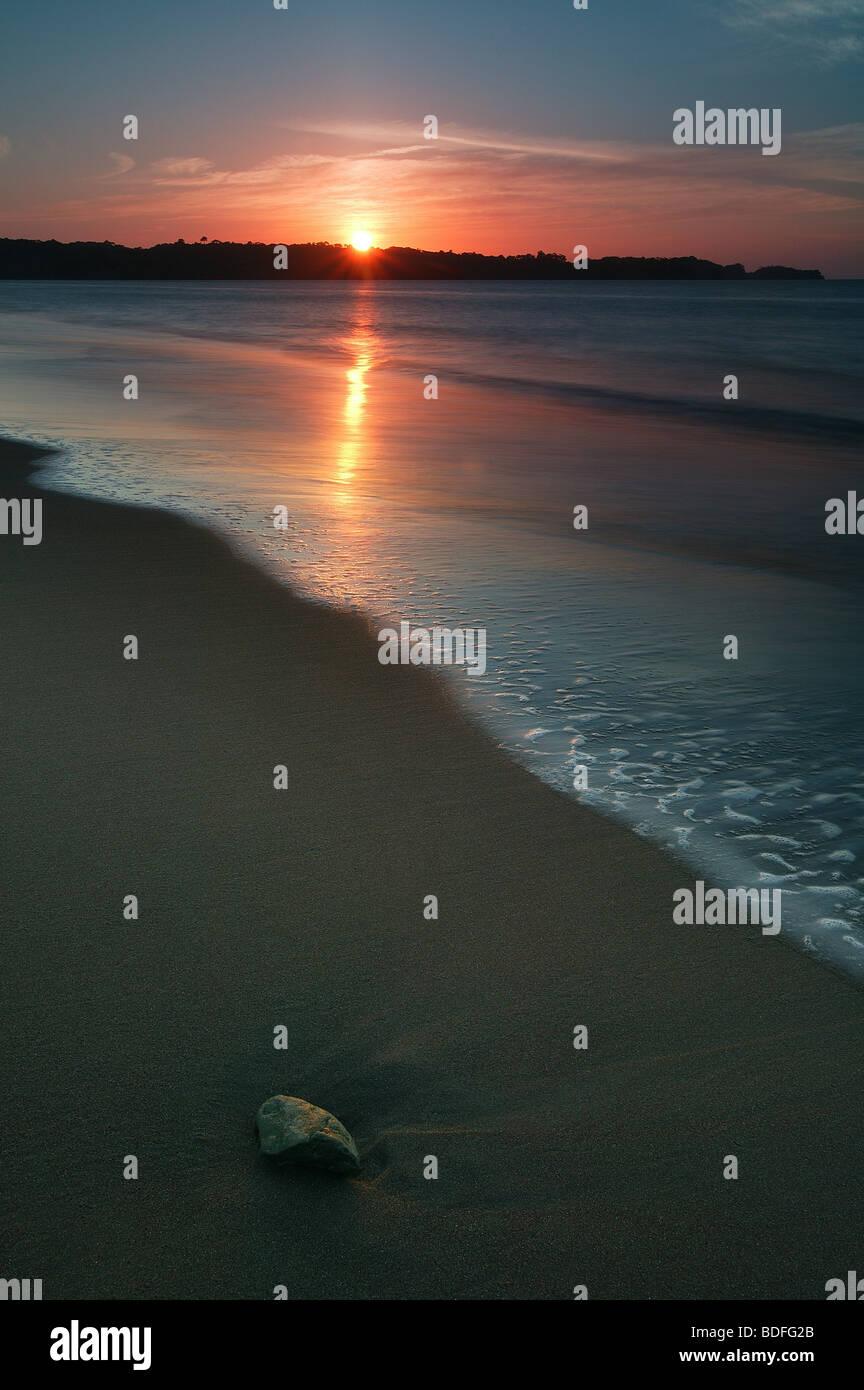 Sunset at Punta Patino nature reserve, Pacific coast, Darien province, Republic of Panama. - Stock Image