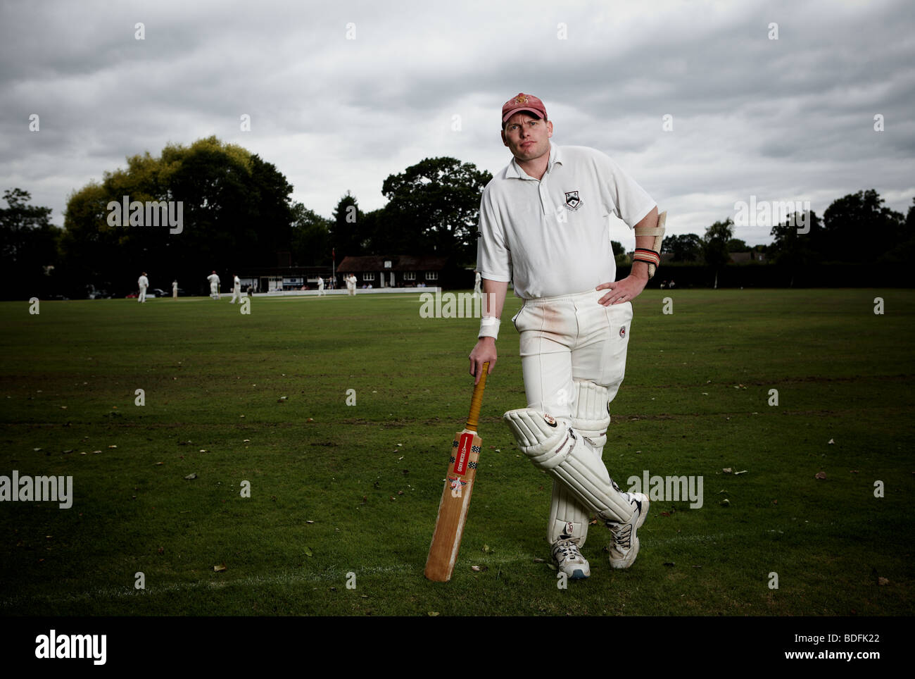 Members of Cockfosters Cricket club pose during a match - Stock Image